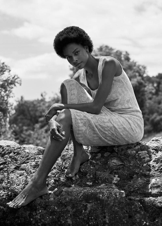 Karly Loyce poses in Mango openwork detail linen dress.
