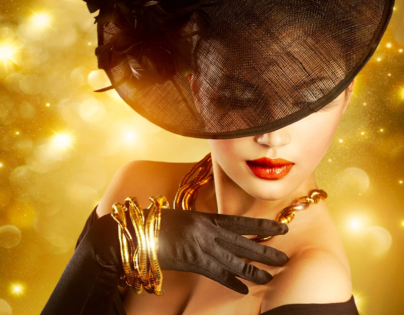 Model Wearing Gold Jewelry Wide Hat Gloves Glamour