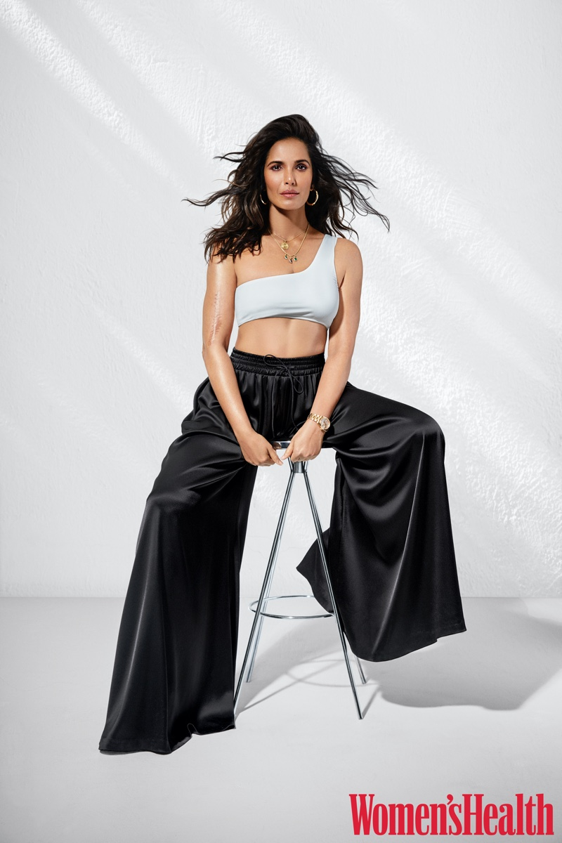 Padma Lakshmi wears Aexas top, Alice + Olivia pants, Ash shoes and Jennifer Fisher earrings.