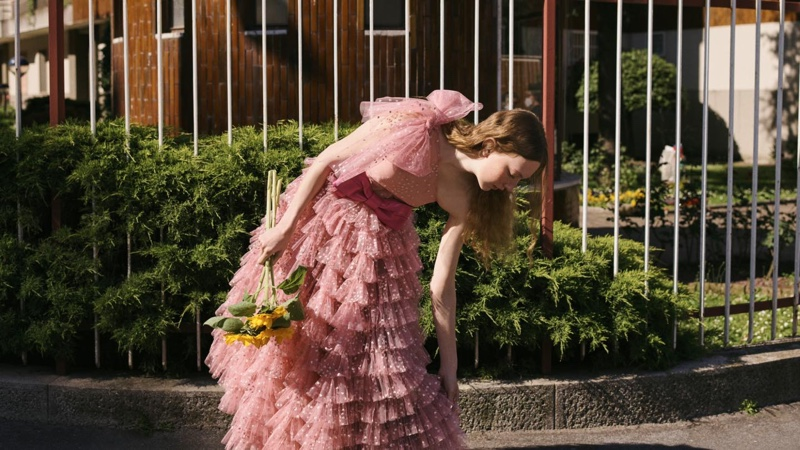 Pink dresses take the spotlight in RED Valentino fall-winter 2020 campaign.