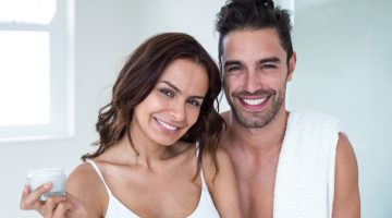 Smiling Man Woman Bathroom Skincare