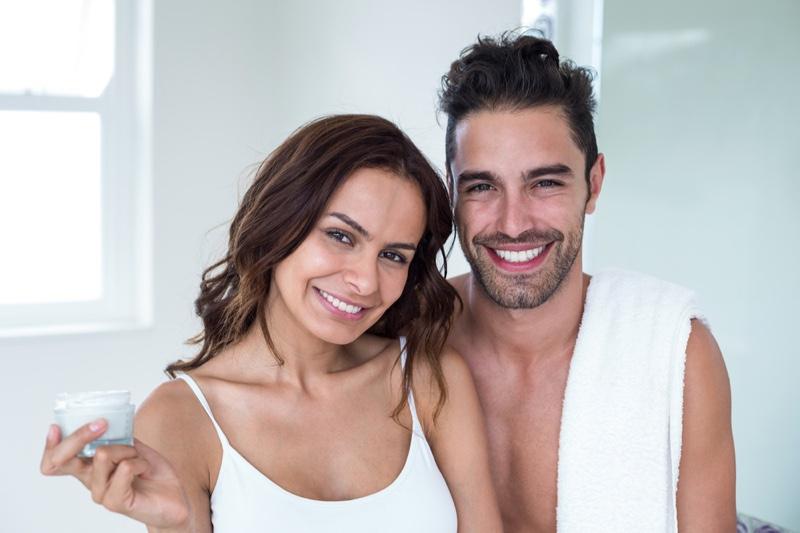 Smiling Man Woman Bathroom Skincare