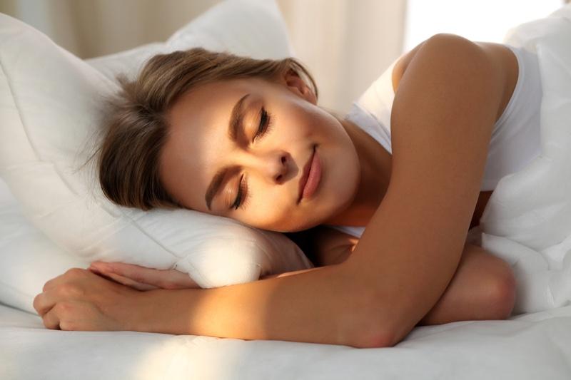 Smiling Woman Sleeping Sun Rays Bed