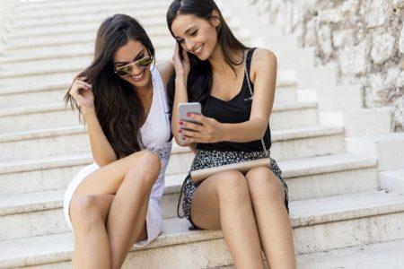 Smiling Women Looking Phone