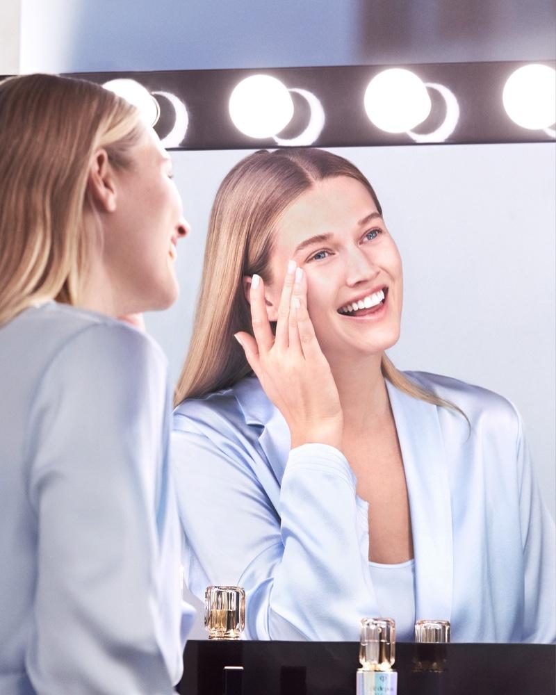 Toni Garrn flashes a smile in Clé de Peau Beauté Le Serum shoot.