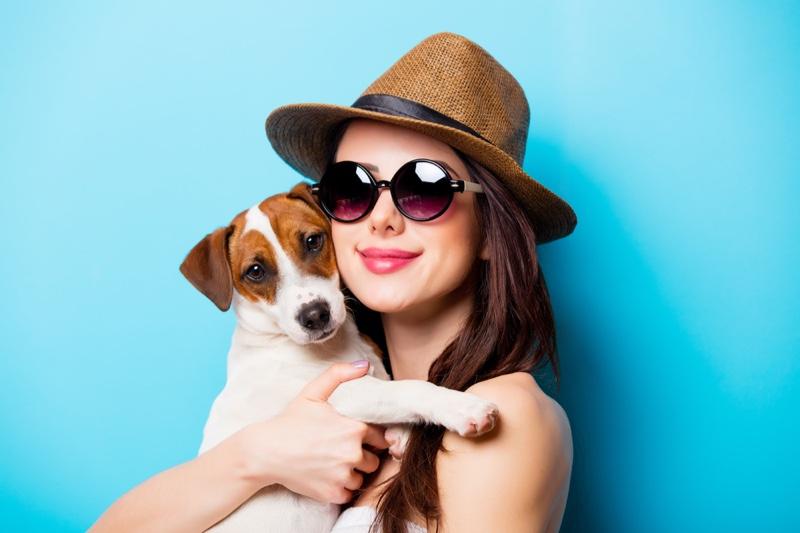 Woman Holding Dog Smiling Sunglasses Hat