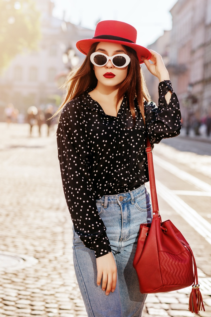 Woman Red Hat Polka Dot Shirt Bucket bag Sunglasses