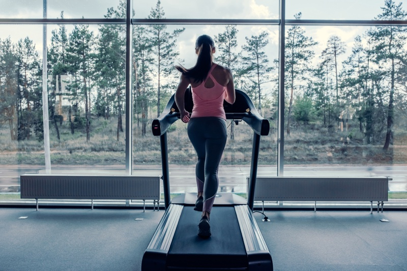 Woman Running Treadmill From Behind Pink Top