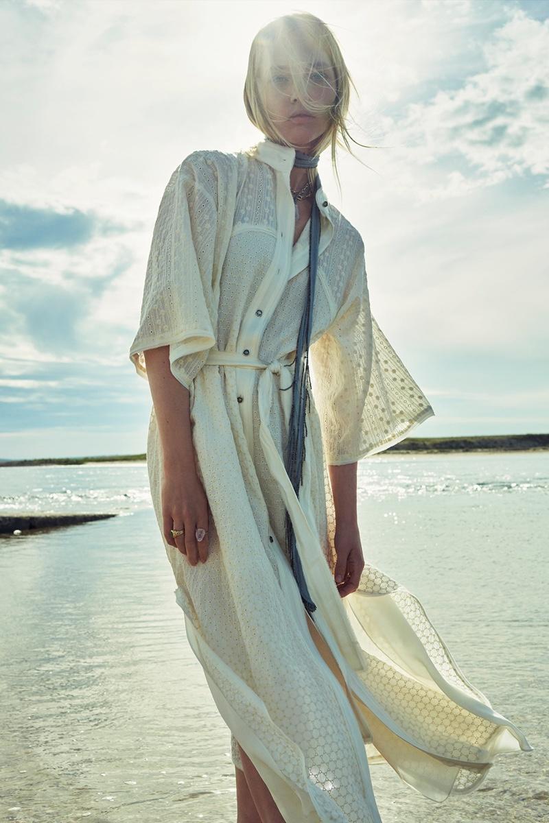 Sasha Pivovarova wears Zara Limited Edition belted dress.