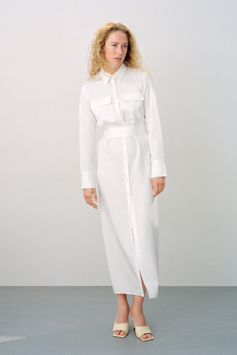 Model Raquel Zimmermann wears Zara Join Life belted shirt dress.