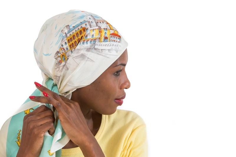 African Woman Tying Hair Scarf