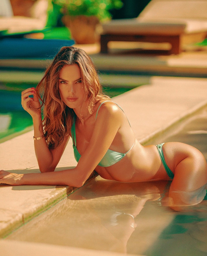 Heating up the pool, Alessandra Ambrosio models her Gal Floripa swimsuit line.
