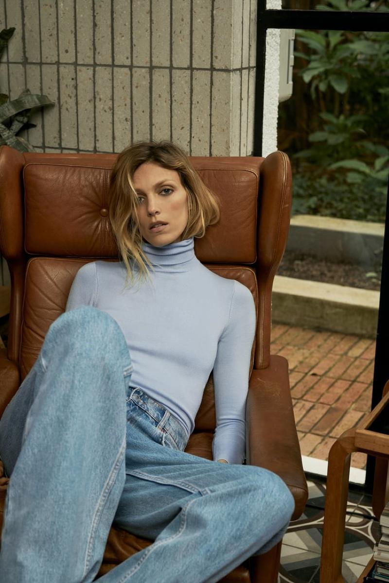 Anja Rubik models Zara turtleneck sweater and blue jeans.