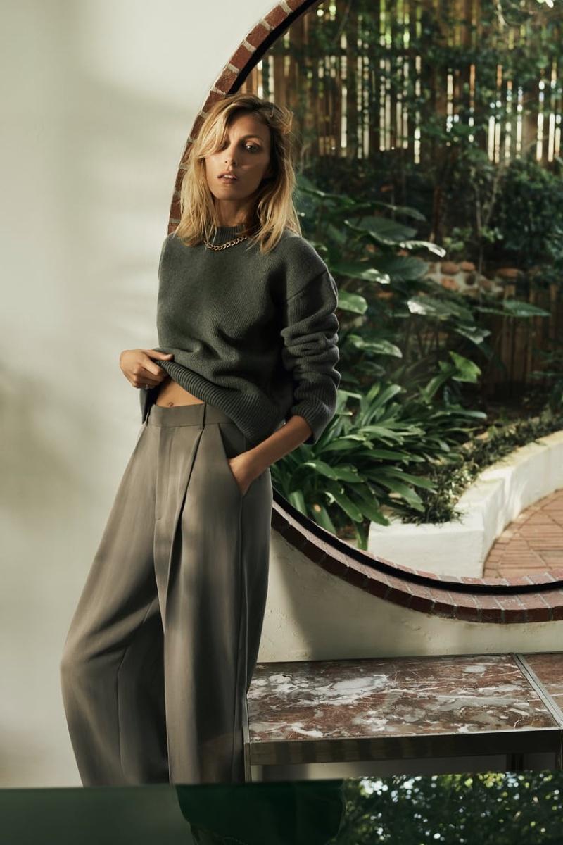 Anja Rubik poses in Zara wool sweater and trousers.