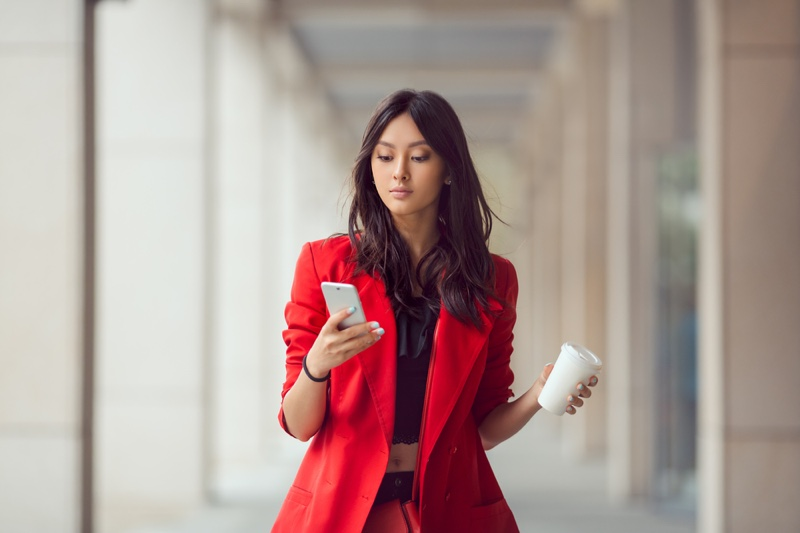 Asian Woman Business Looking Phone Cup