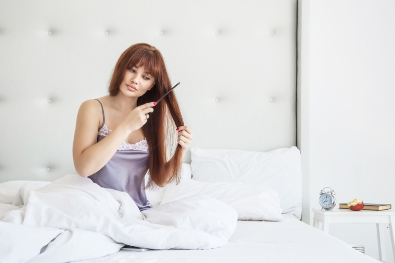 Attractive Woman Combing Hair Bed Mattress