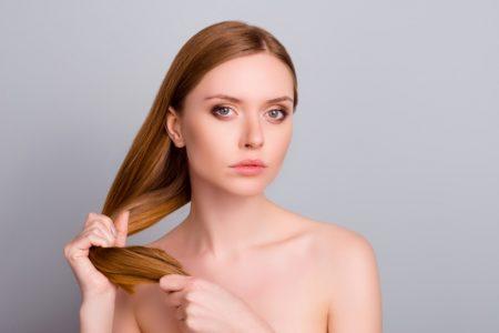 Beauty Model Holding Hair