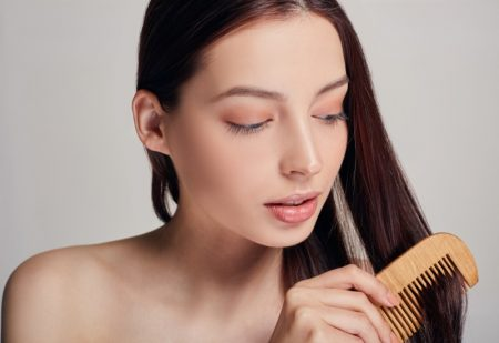 Brunette Woman Combing Hair Beauty