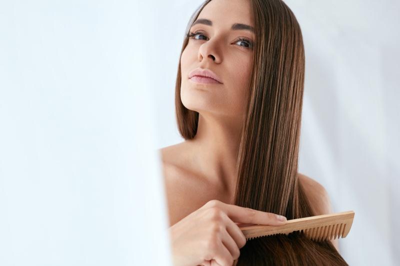 Brunette Woman Long Hair Combing