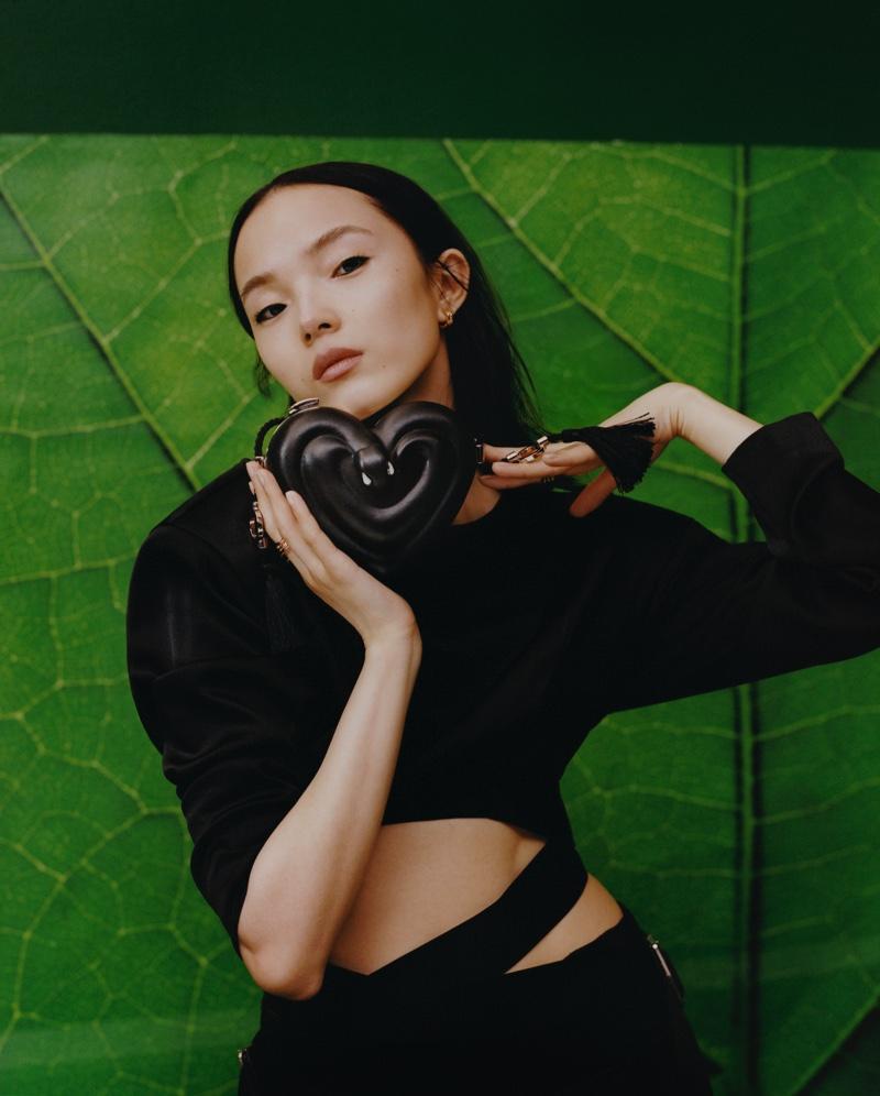 Xiao Wen Ju poses for Bulgari x Ambush accessories campaign.