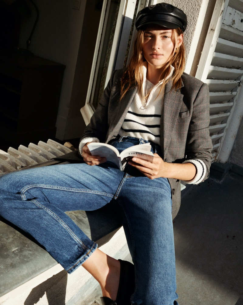 With a book in hand, Grace Elizabeth tries on Mango's fall 2020 collection.