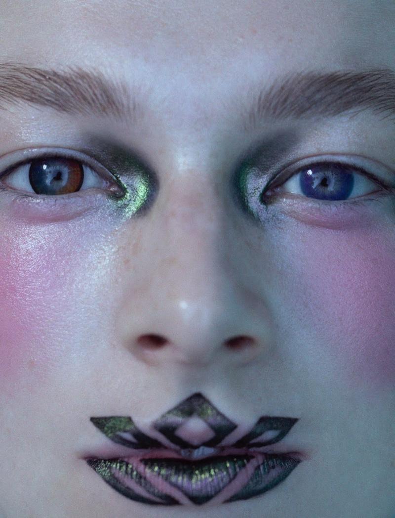Ready for her closeup, Hunter Schafer wears glittery eye makeup.