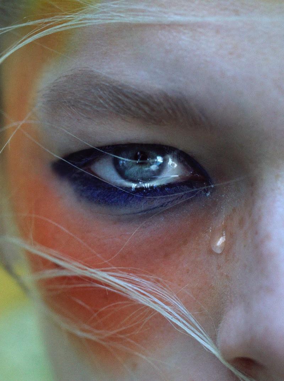 Hunter Schafer wears multi-colored makeup.