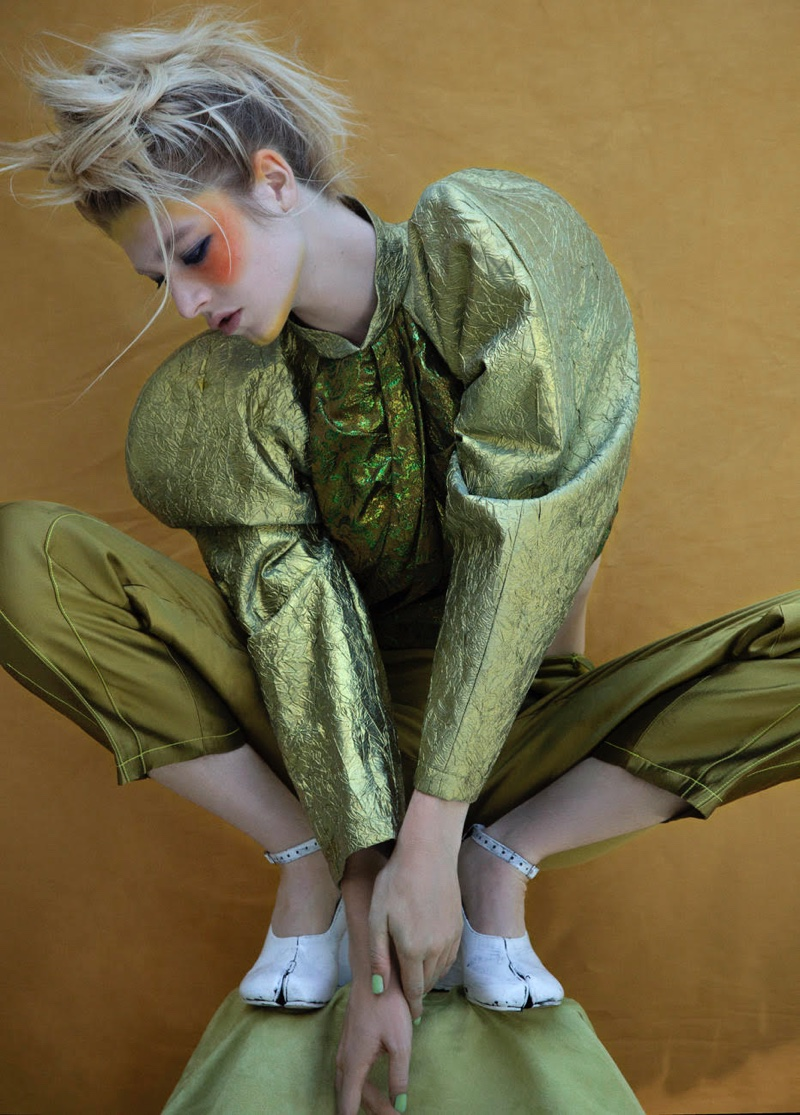Hunter Schafer poses in John Rogers top and pants.