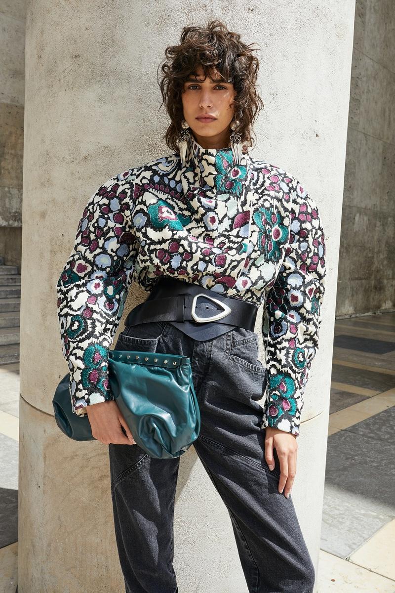Model Mica Arganaraz poses in Paris for Isabel Marant fall-winter 2020 campaign.