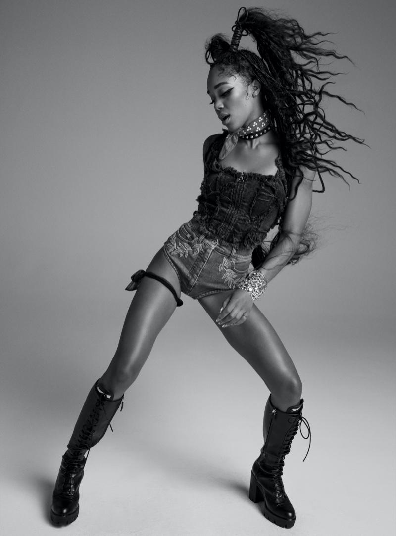 Laura Harrier poses in Eckhaus Latta top, Moschino shorts, Giuseppe Zanotti boots and Chrome Hearts jewelry.