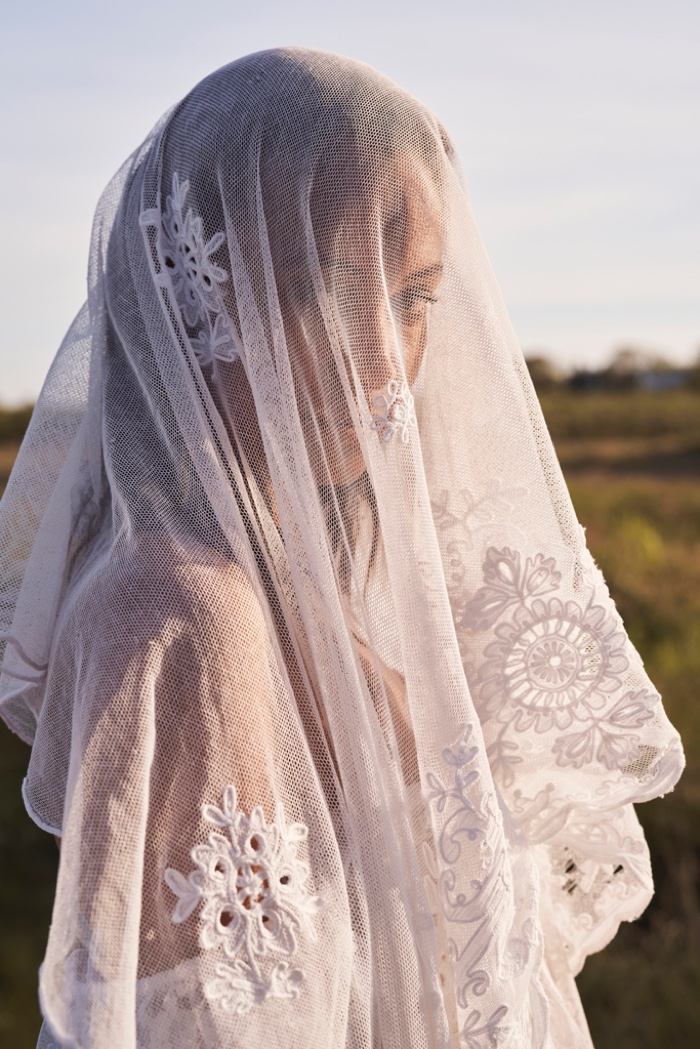 Chantal Monaghan models veil design in LoveShackFancy Bridal summer 2020 campaign.