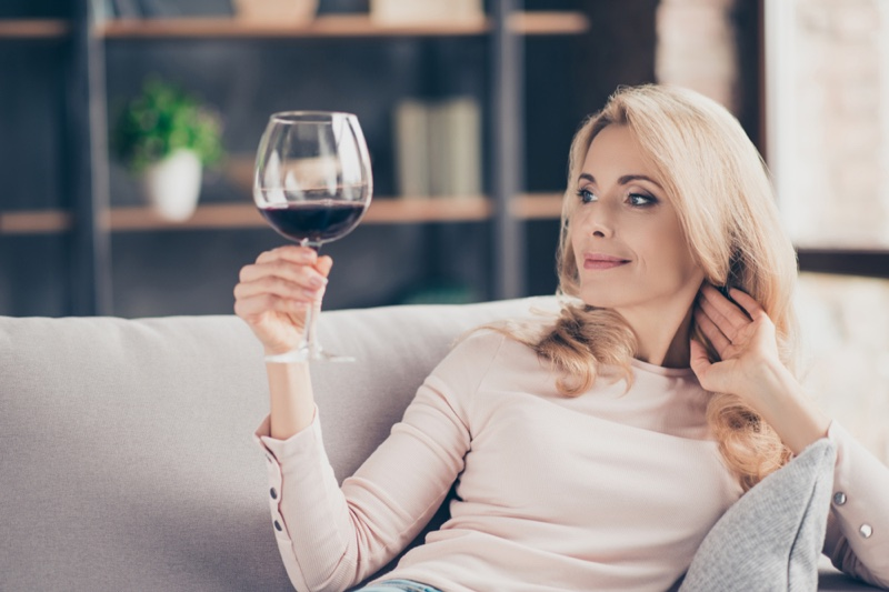 Older Woman Smiling Wine Glass
