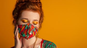 Redhead Woman Printed Face Mask Bold Eyeshadow Makeup