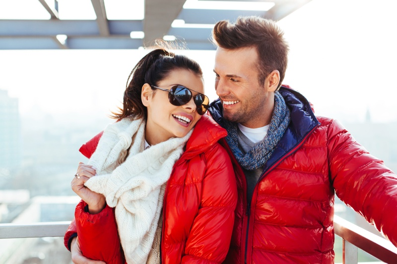 Smiling Couple Red Jackets Outdoors