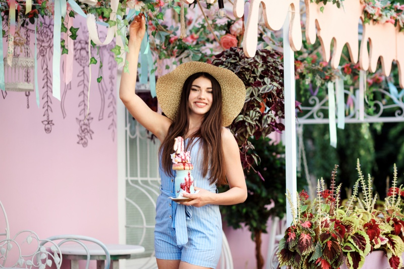 Smiling Woman Blue Romper Cafe Outdoors