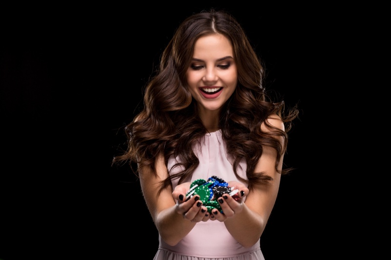 Smiling Woman Holding Casino Chips Pink Dress