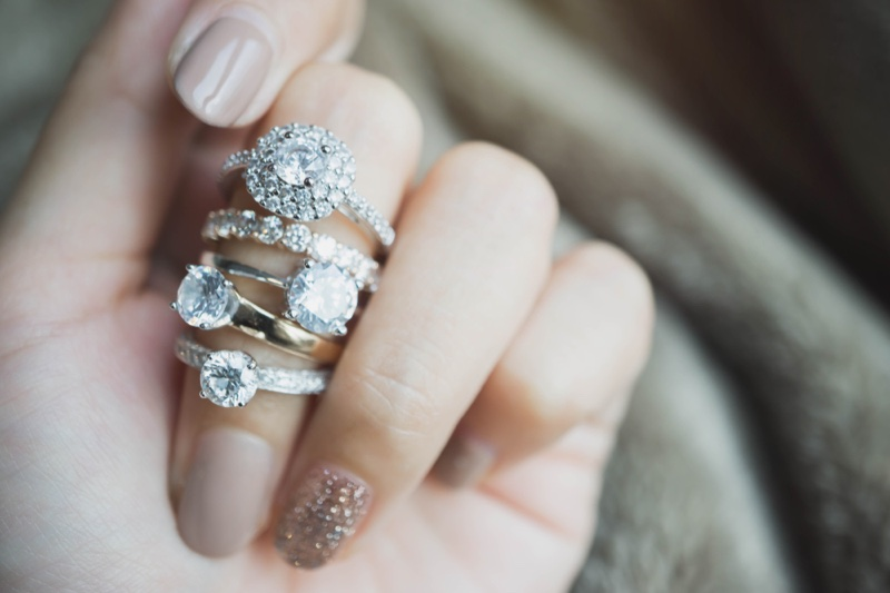 Stack Diamond Engagement Rings Woman's Hand Closeup