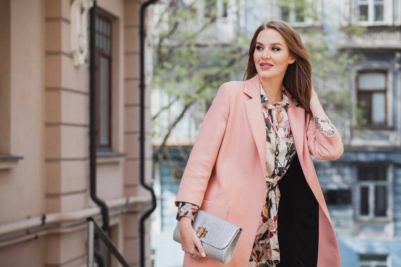 Stylish Woman Pink Blazer Floral Print Holding Bag