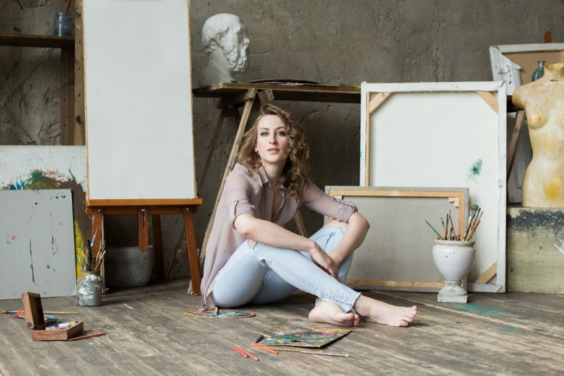 Woman Artist Sitting Paintings Studio