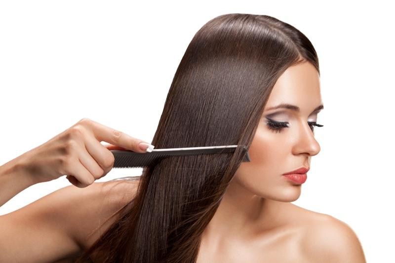 Woman Combing Long Dark Hair Beauty