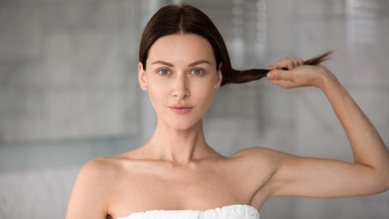 Woman Holding Thin Hair Bathroom