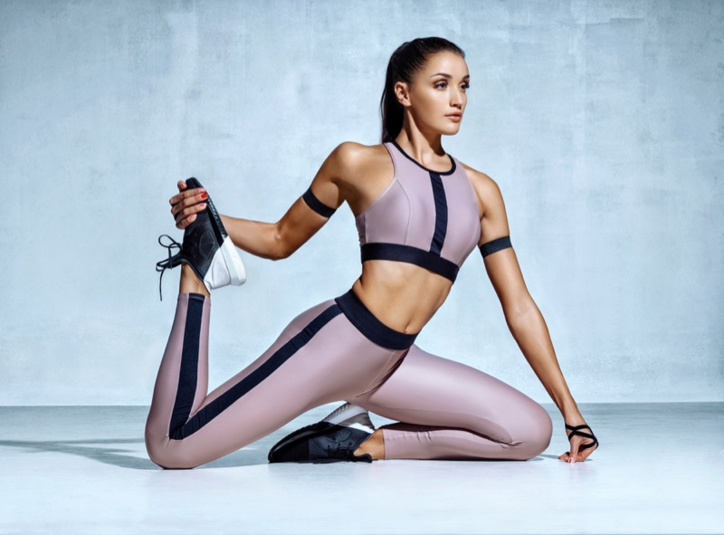 Woman Stretching Athletic Outfit Leggings Top