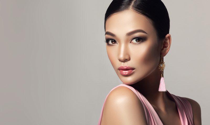 Woman with Pink Tassel Earrings