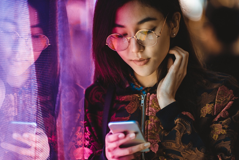 Asian Woman Glasses Phone Brocade Jacket