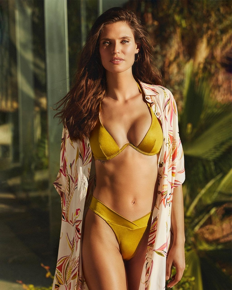 Shining in gold, Bianca Balti fronts Yamamay Swim 2020 campaign.