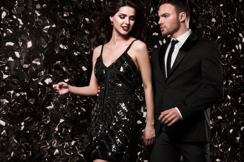 Glamorous Couple Woman Sequin Dress Man Suit Shiny Background