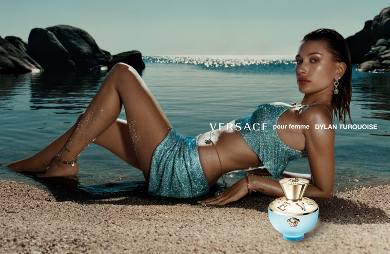 Hailey Baldwin poses for Versace Dylan Turquoise fragrance campaign.