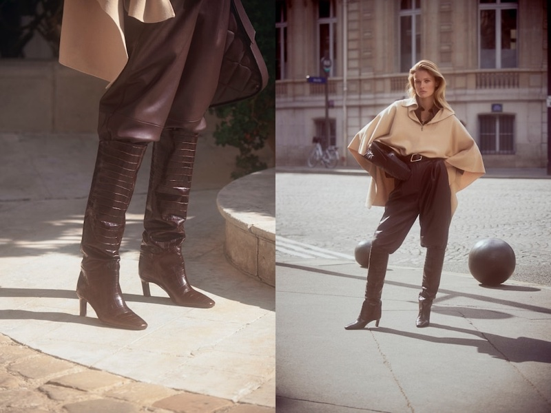 Edita Vilkeviciute wears Massimo Dutti cape with half-zip neck, leather shirt, Limited Edition leather trousers, and leather boots.