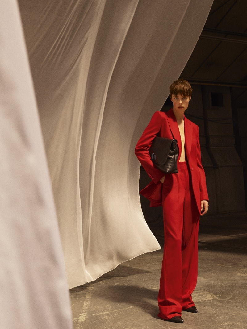 Edie Campbell suits up in red for Massimo Dutti Limited Edition fall-winter 2020 collection.