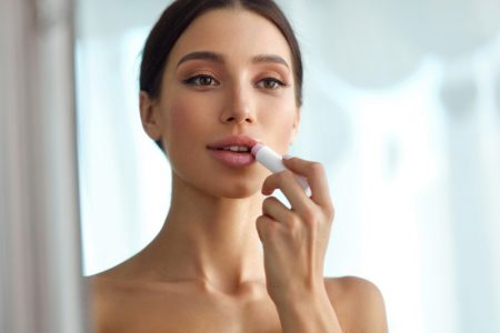 Model Applying Lip Balm Makeup Beauty